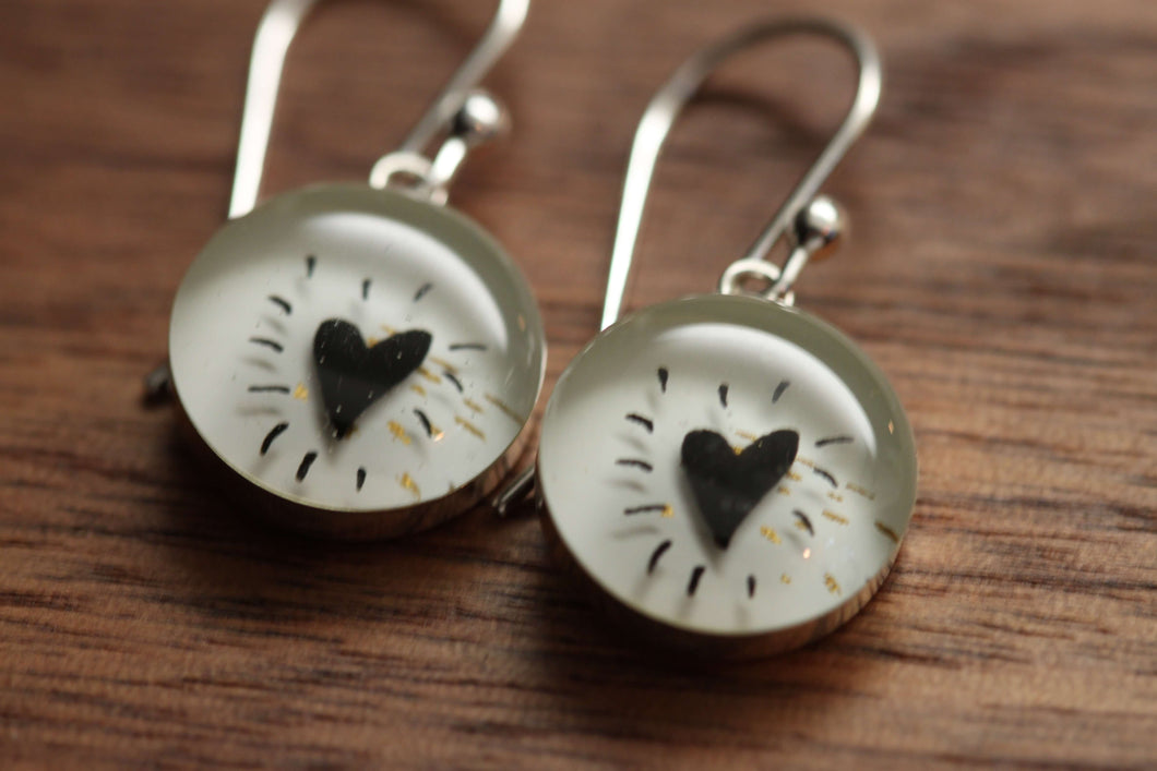 Black heart earrings made from recycled Starbucks gift cards. sterling silver and resin