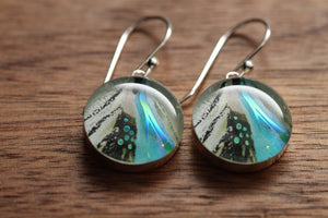 Blue Feather earrings made from recycled Starbucks gift cards. sterling silver and resin