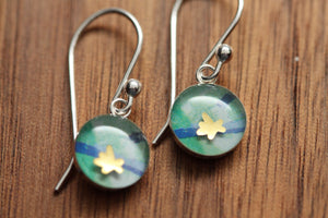 Tiny golden flower earrings made from recycled Starbucks gift cards, sterling silver and resin