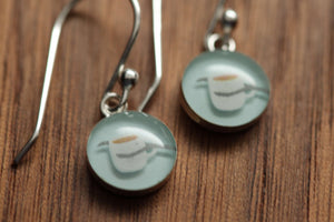 Tiny coffee cup earrings made from recycled Starbucks gift cards, sterling silver and resin