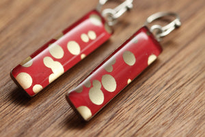 Red and gold polka dot earrings made from recycled Starbucks gift cards, sterling silver and resin