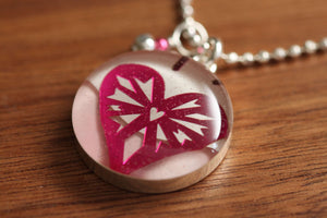 shiny pink heart necklace made from recycled Starbucks gift cards, sterling silver and resin