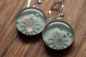 Snowflake sparkle earrings made from recycled Starbucks gift cards, sterling silver and resin