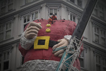 Load image into Gallery viewer, Auckland Santa. Scaffolders guiding Santas head into position