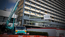 Load image into Gallery viewer, Scaffold being craned into position on Copthorne Refurbishment