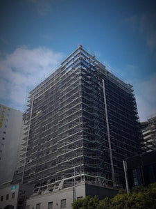 The International Apartments under construction with scaffolding