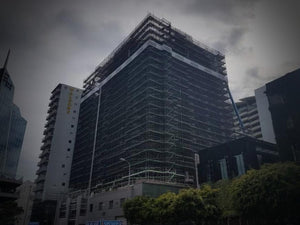 International Apartments under construction, covered in scaffolding and scrim