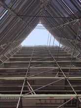 Load image into Gallery viewer, The International Apartments, looking up the scaffolding