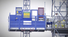 Load image into Gallery viewer, Geda 1200 Hoist being loaded on a construction site