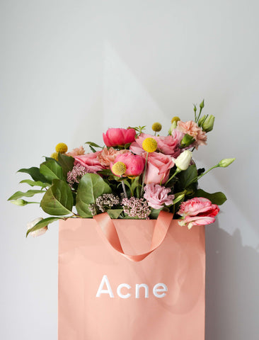 Bouquet of flowers in a paper bag branded acne