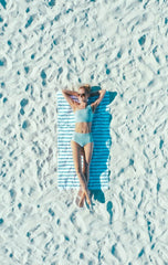 Girl tanning on a sandy beach