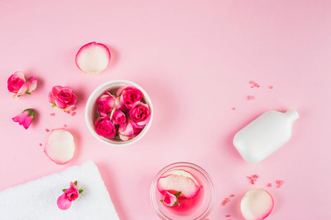 Pink table with rose petals