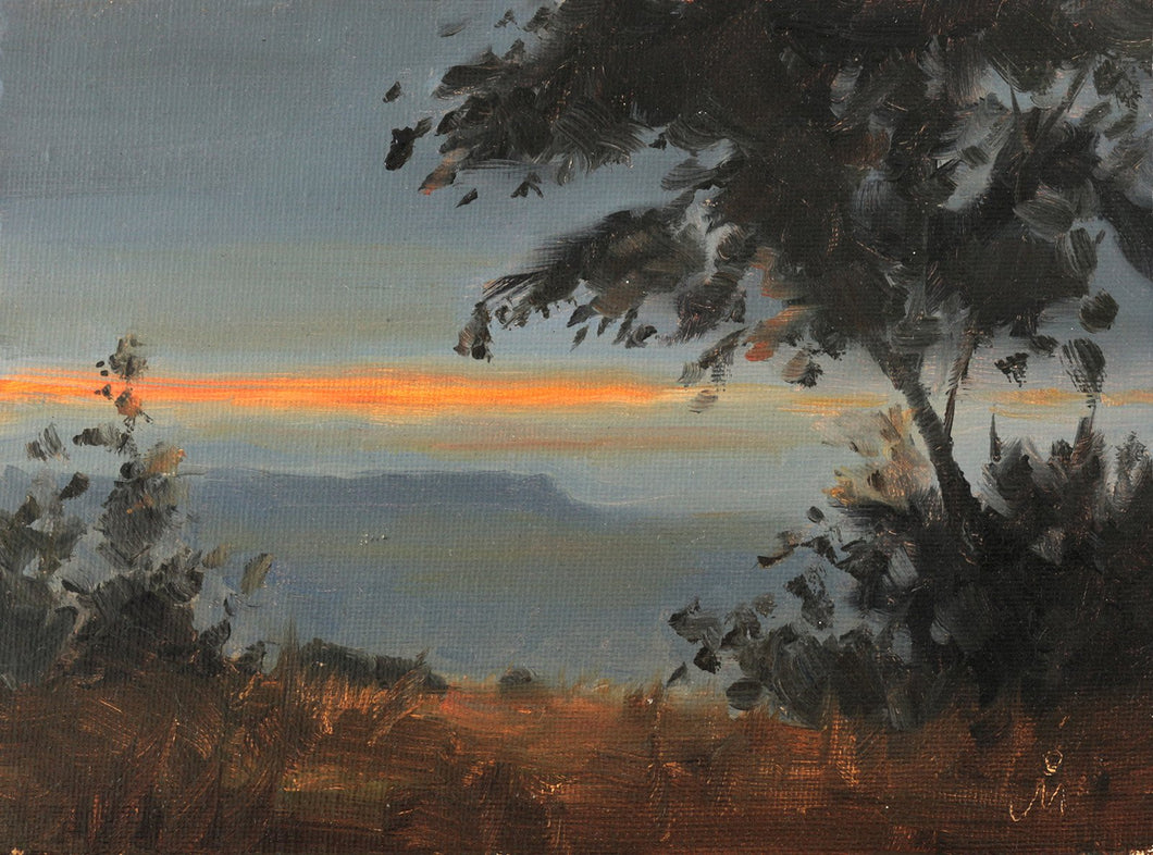 Landscape painting showing a streak of sunset colors in evening sky, behind a distant mountain. Foreground trees appear only as silhouettes.