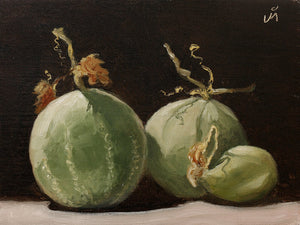 Still life painting showing three dramatically lit musk melons againsta a dark background.
