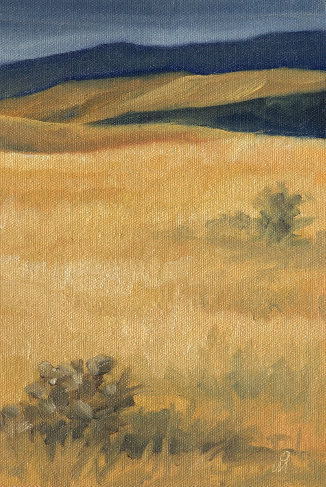Landscape painting showing dried grass and a few shrubs in the major portion of the painting with a hint of grey violet distant mountain and pale sky towards the top.