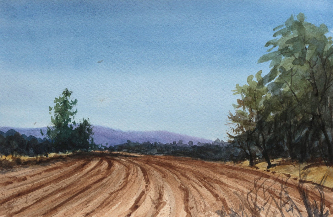 Landscape painting of ploughed farm, some trees on the farm's edge, distant mountain and a clear blue sky.