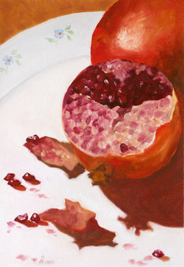Oil painting of one whole and one half pomegranate kept on white plate.