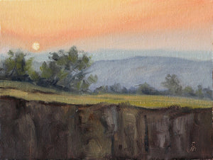 Landscape painting of sunset seen from the top of a hill.