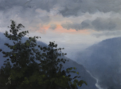 Landscape painting of a dawn seen from the top of a wooded hill. Pink sky peeps through dark clouds and the hills appear blue.