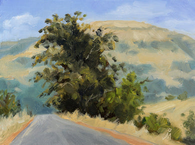 A sunny landscape painting of an empty road towards the base of a mountain. A big tree is seen on the roadside.