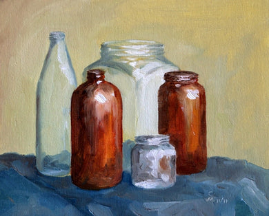 Oil Painting showing 5 bottles of different sizes and shapes kept on a blue cloth.