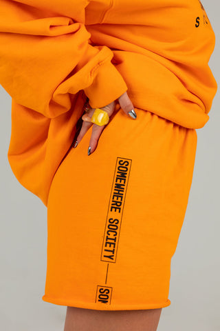 SOMEWHERE SOCIETY ORANGE SWEATSHORTS
