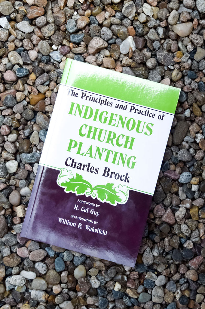 Indigenous Church Planting book on background with pebbles