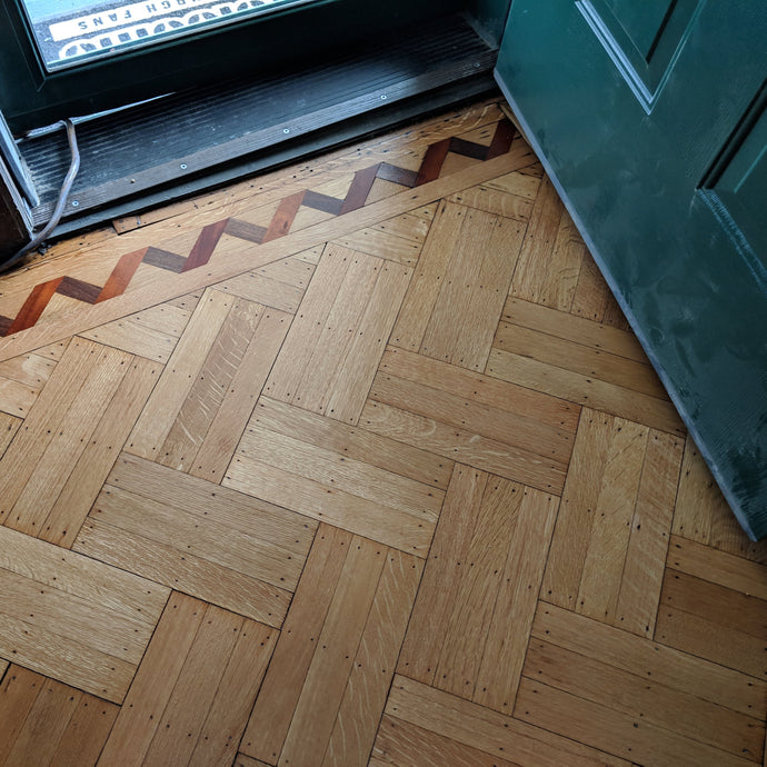 Parquet Refinish Creates a Stunning Focal Point to Entryway