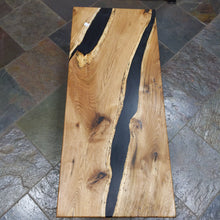 Load image into Gallery viewer, Butternut Coffee Table reverse live edge with black epoxy river on metal base 19x45