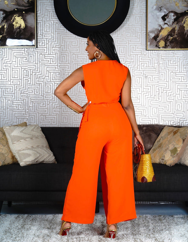 Tomato orange sleeveless crossover jumpsuit.