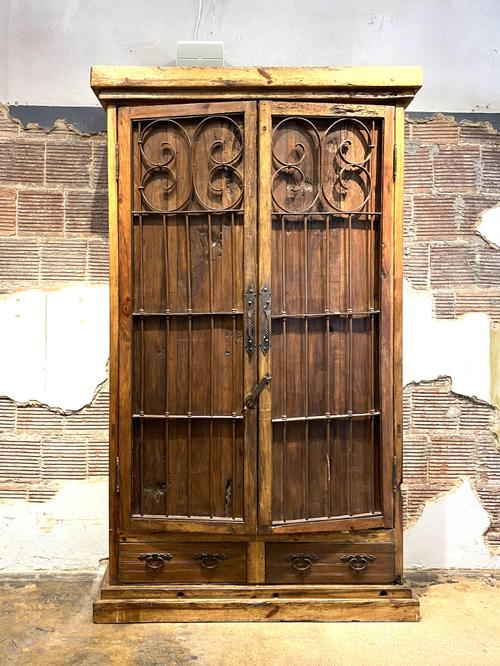 Old calabozo armoire in reclaimed wood and antique iron gate and rustic nails.