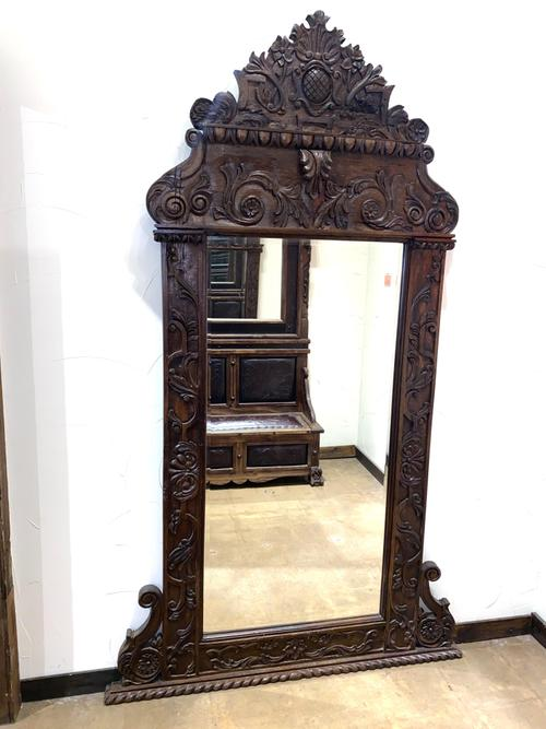 Hand carved floor mirror.