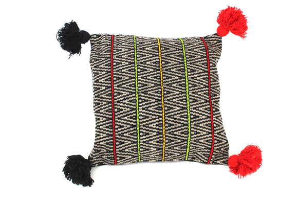 Hilos & Colores. Cotton Pillow with Tassels and Black Background. Ayacucho, Peru.