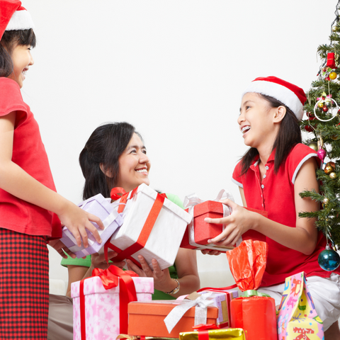 Filipino Family exchanging gifts