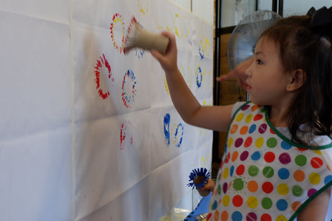 Little girl painting fireworks at a Filipino Fiesta Playdate