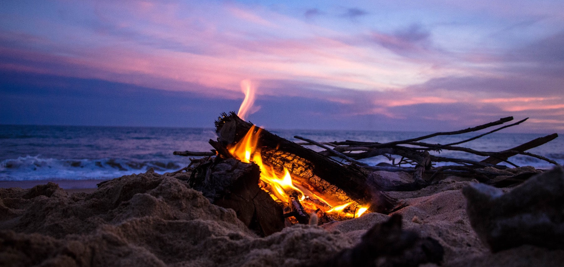 Beautiful view by the ocean with a campfire