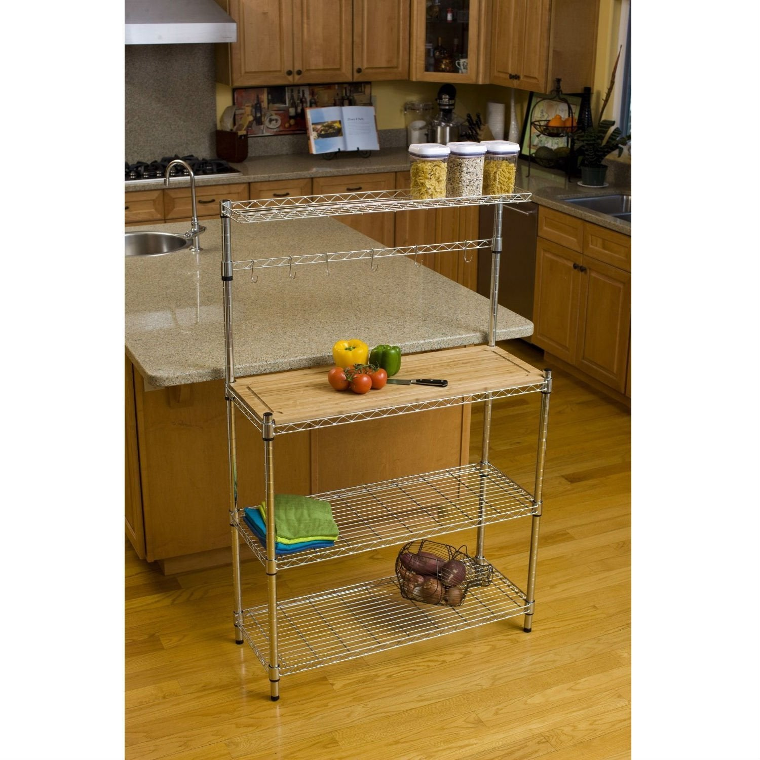 Metal Bakers Rack with Hanging Bar and Bamboo Cutting Board.