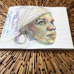 softcover book on wooden table. image on book is a line drawing of the writer ntozake shange