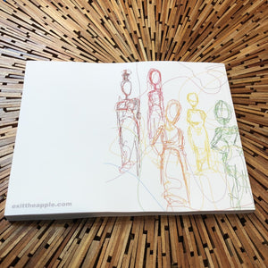 softcover book on wooden table. image on book is a line drawing of multiple figures of women, each drawn in a different color