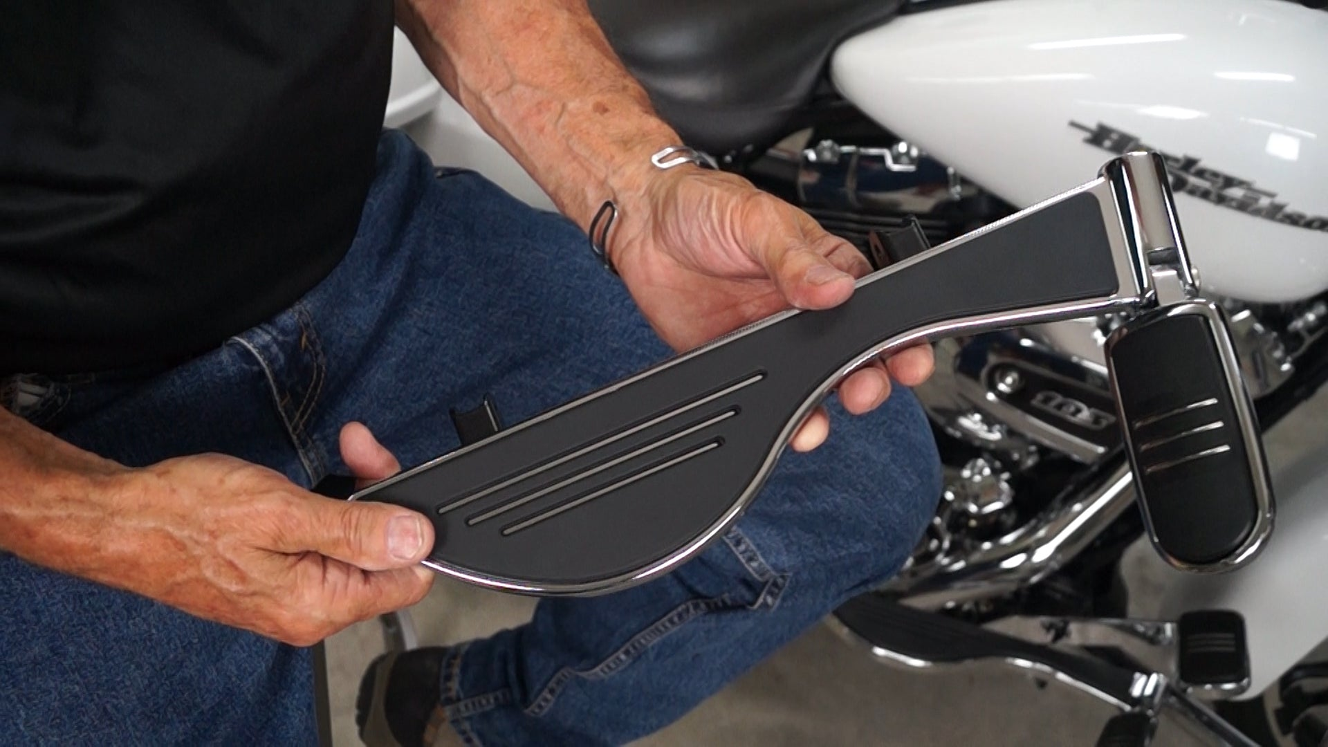 Michael Anthony holds Pegboard Motorcycle Floorboard