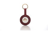Round Key Ring | leather | leather fashion | fashion accessories | leather accessories | key holder |  keychain | Made in Italy | craftsmanship | Makebe | bordeaux | white |