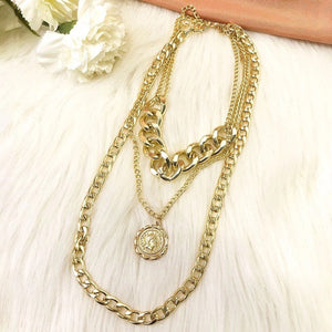 Chains and coin necklace