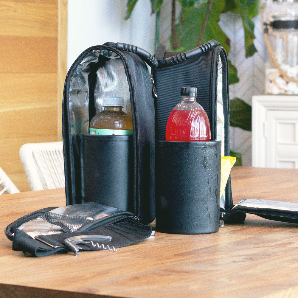 CaddyO Dual Tote by ChillnJoy with three protective layers of protection, adjustable shoulder strap, multi-functional corkscrew bottle opener and foil cutter, and six storage pockets. Zips apart to become two individual bags – each with a rugged carrying handle. FREE with the purchase of two iceless bottle chillers