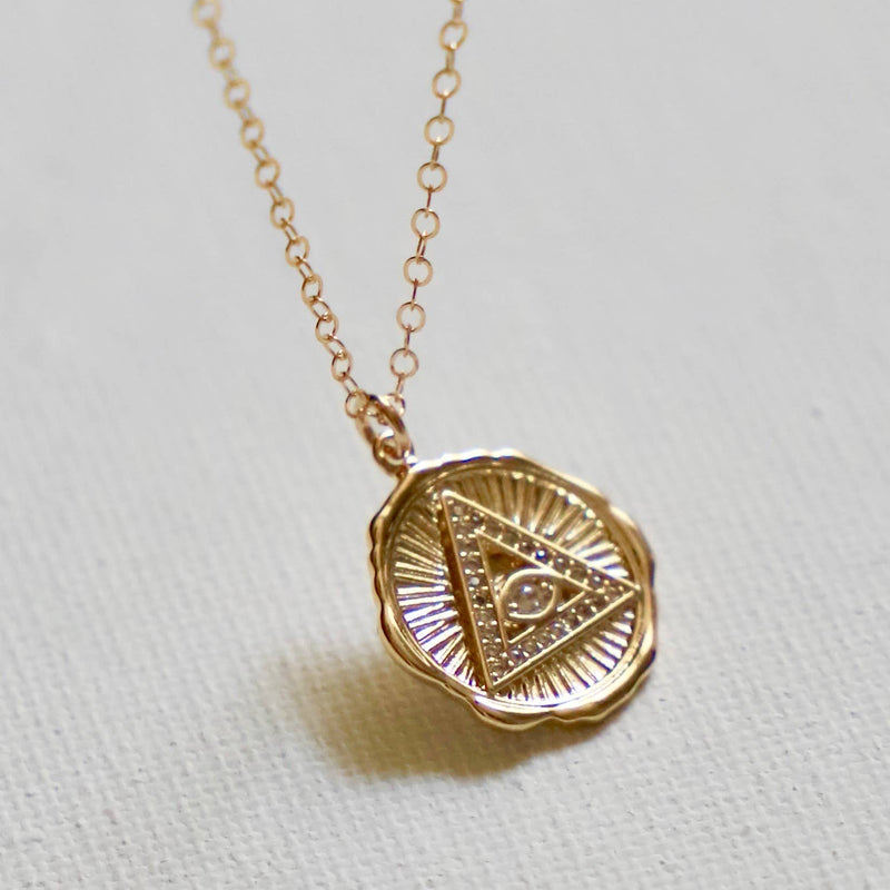 GOLD PLATE PYRAMID AND EVIL EYE MEDALLION