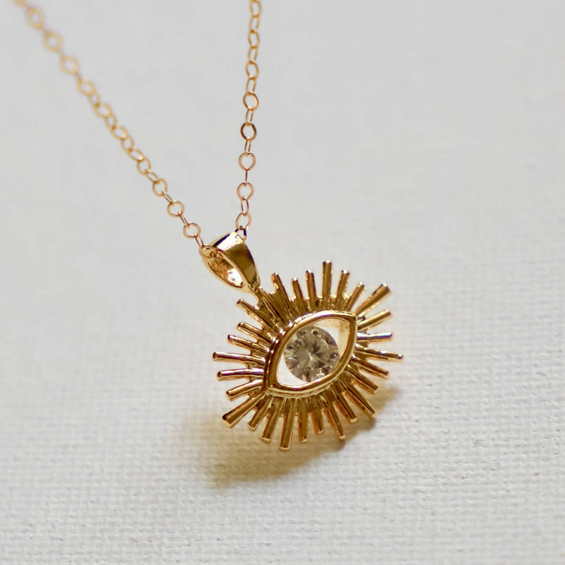 GOLD PLATE EVIL EYE AND CZ SILHOUETTE