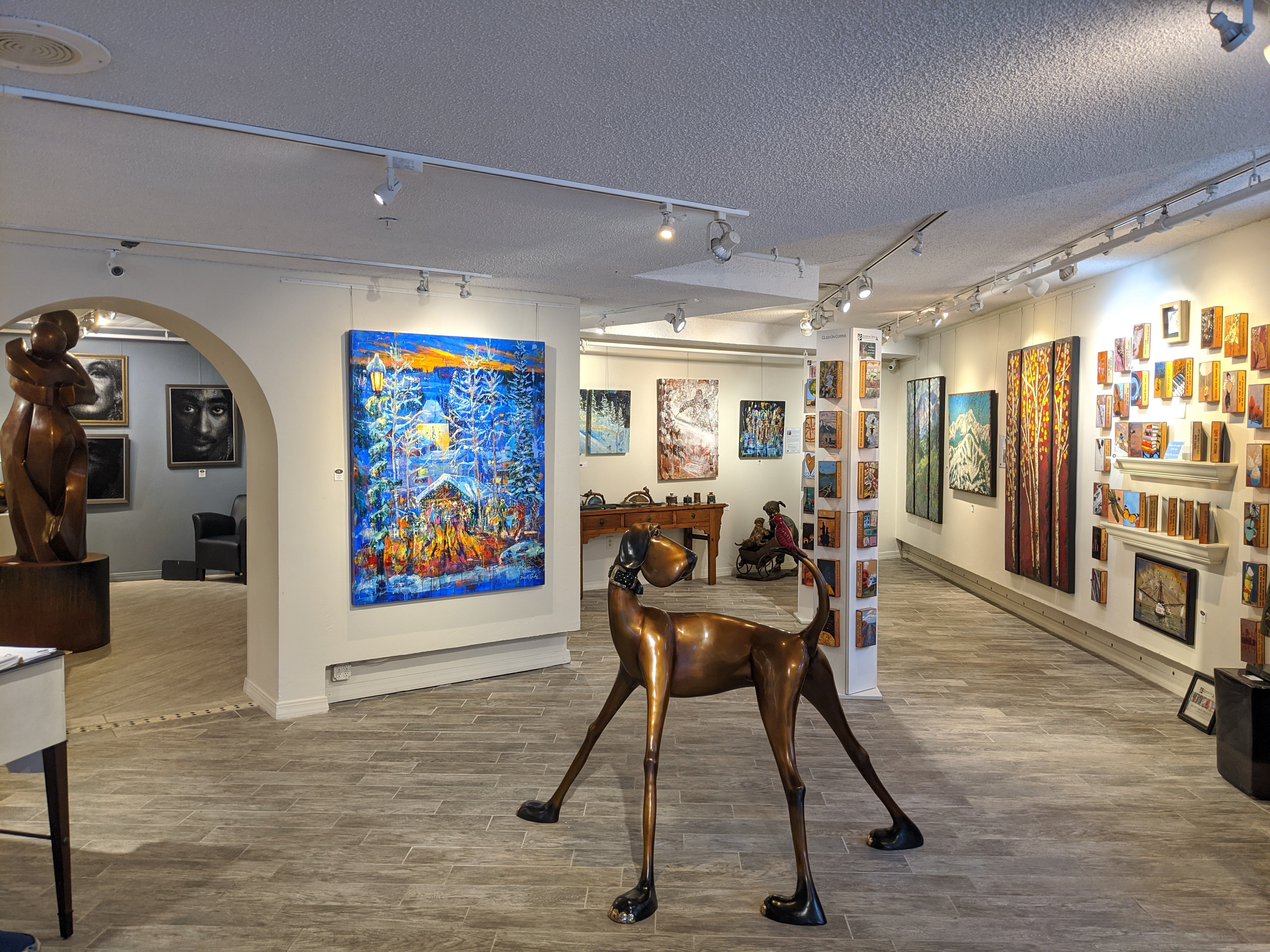 Raitman Art Galleries Vail, Colorado. Showing Paintings and Sculptures by Artists Marty Goldstein, Rolinda Stotts, David V. Gonzales, Houston Llew, Fekadu Mekasha, Mark Yale Harris and Marianne Caroselli