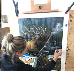 Maxine Bone working on her original Elk Painting Call Of The Wild