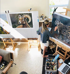Artist Maxine Bone painting in her studio