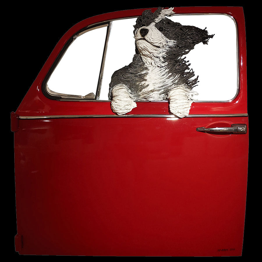 Sheepdog in a Red Volkswagen door original created by Colorado artist DD Larue