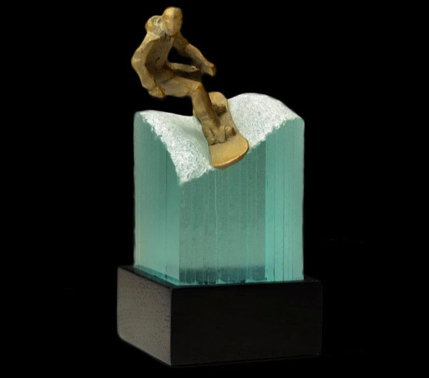 Carver bronze and glass sculpture created by Colorado artist Clay Enoch